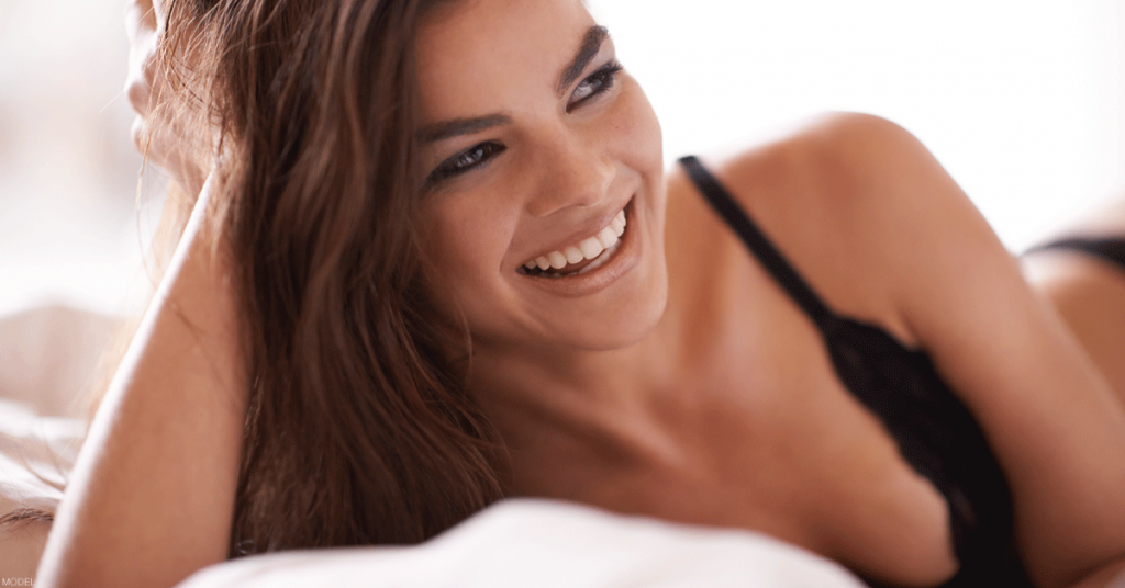 Woman in The Woodlands, TX lying in bed considering breast reduction and wondering what recovery is like