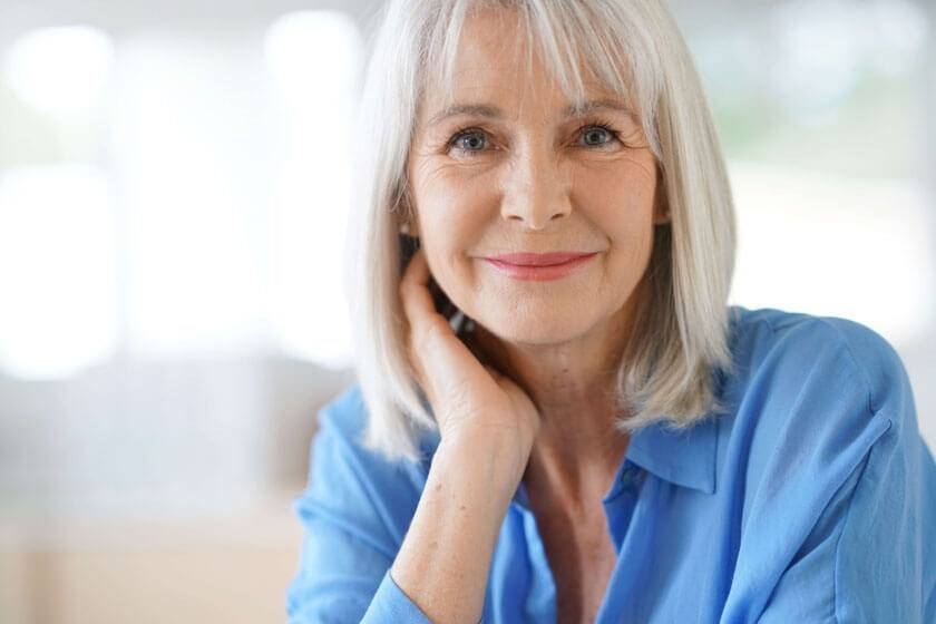 Older woman staring into camera