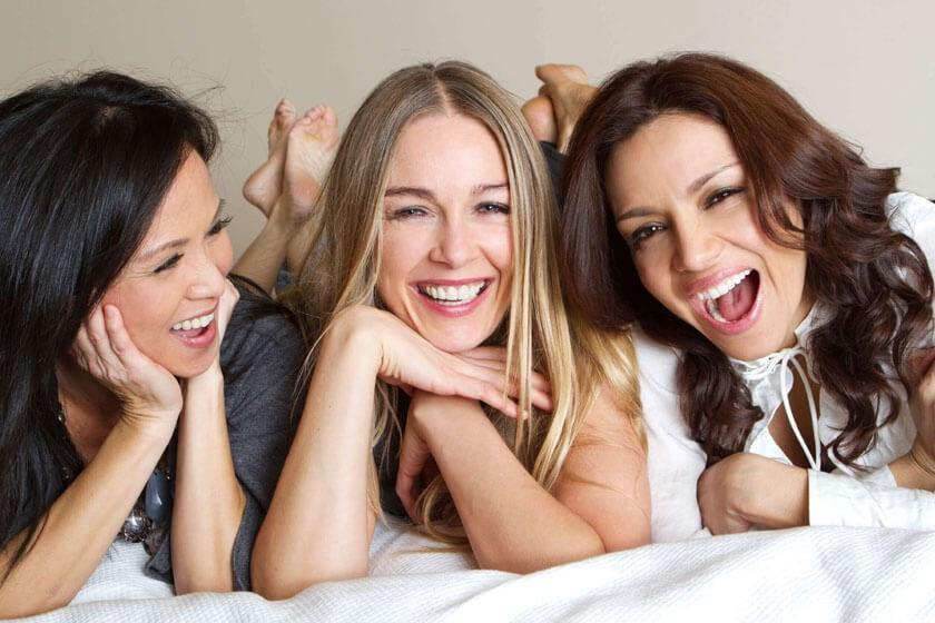 Women laying down and laughing