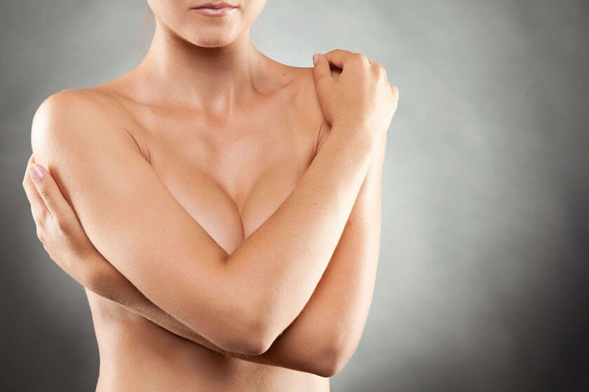 Woman covering her breasts - Breast Augmentation in The Woodlands, TX
