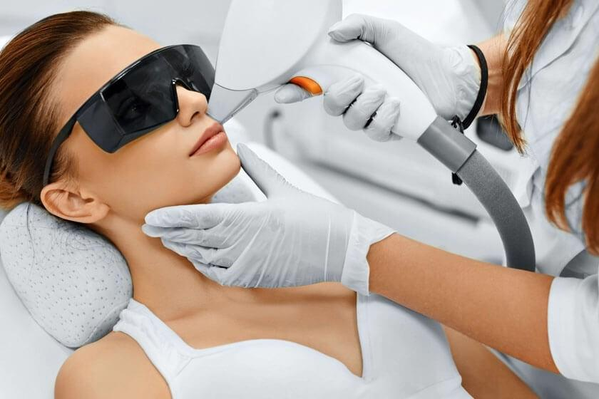 Woman receiving a laser skin treatment in The Woodlands, TX