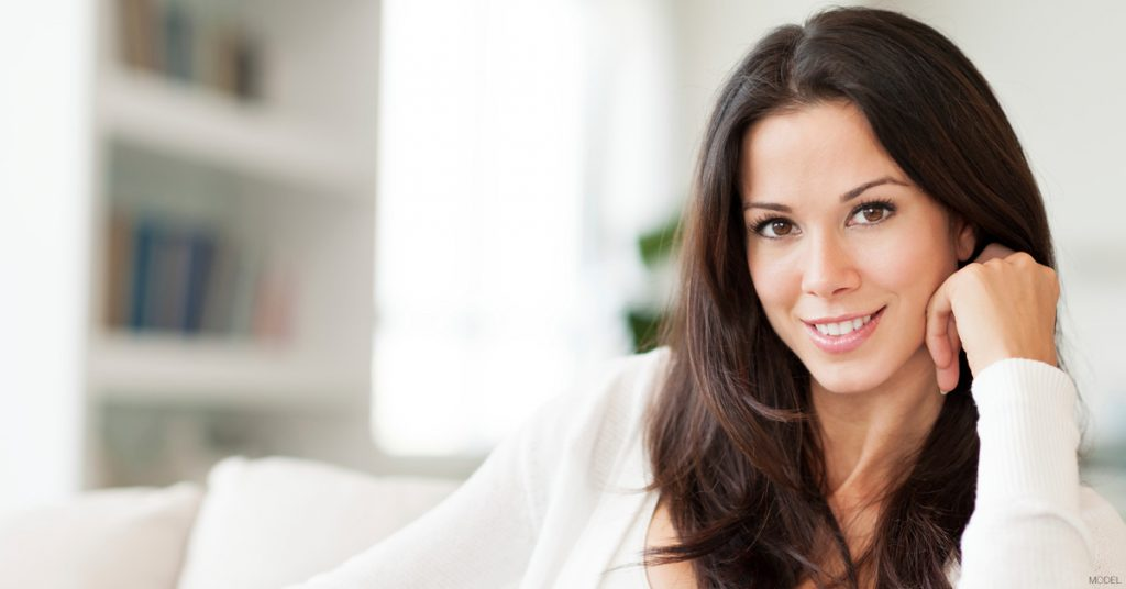 Brunette woman smiling at camera