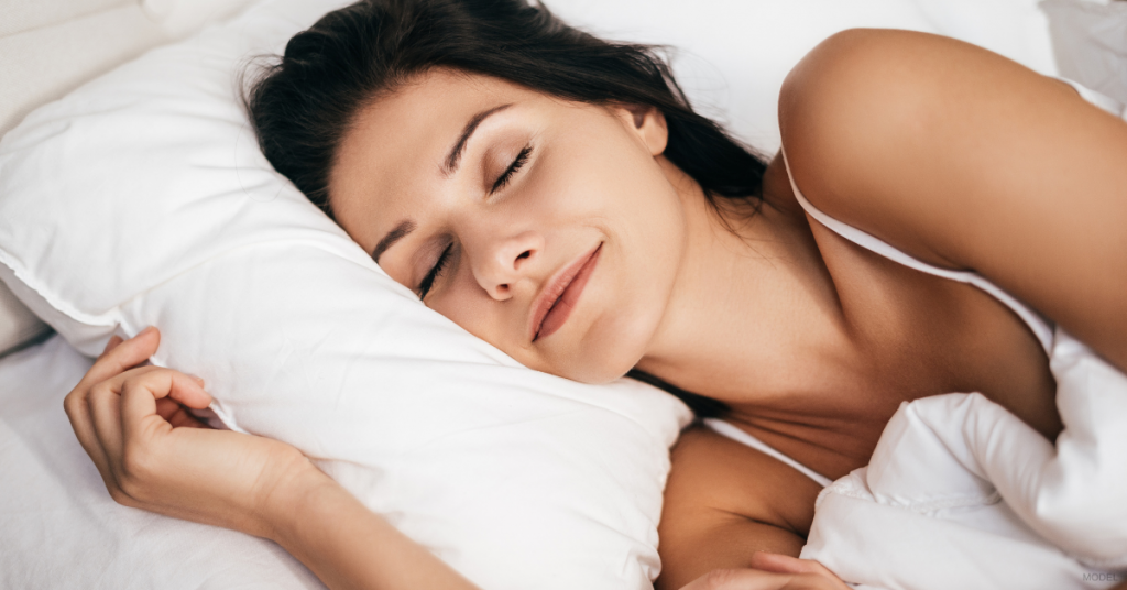 Woman in The Woodlands, TX sleeping comfortably after her mommy makeover procedure (model)